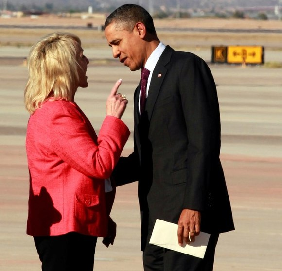 Arizona Gov. Jan Brewer and President Obama in an animated exchange at the airport in Phoenix. (Haraz N. Ghanbari / Associated Press)