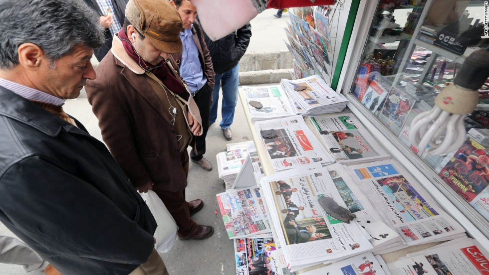 Iranians look at newspapers on November 24, 2013 in Tehran a day after a deal was signed between Iran and the U.S. on the nuclear question. Via CNN>