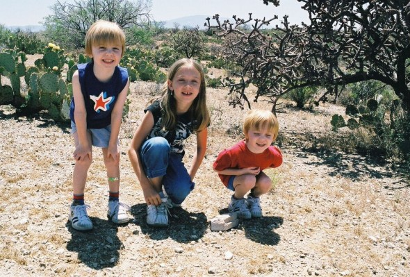 This is my brothers and I. I think I was around eight in this picture, making them around three.